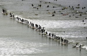 Surfers ride a wave in the annual Earthw